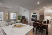 Open concept townhome kitchen living dining room wood style flooring throughout