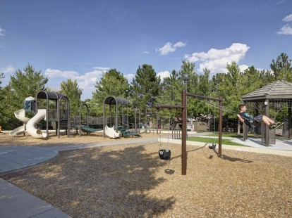 Metro denver playground with swings and pavilion