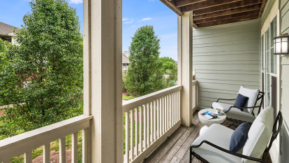 Balcony overlooking community landscaping at Camden Governors Village Apartments in Chapel Hill, NC