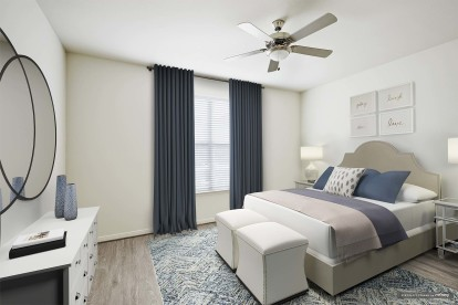 Modern style bedroom with wood style flooring and ceiling fan
