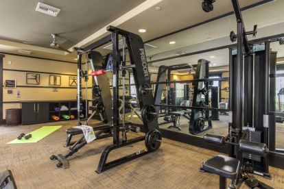 Fitness center weight training and space for pilates mats