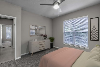 Bedroom with ceiling fan and carpet flooring