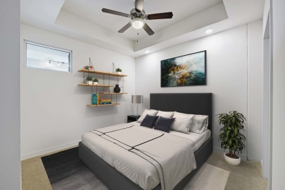 Bedroom with ceiling fan carpet high ceilings and carpet flooring