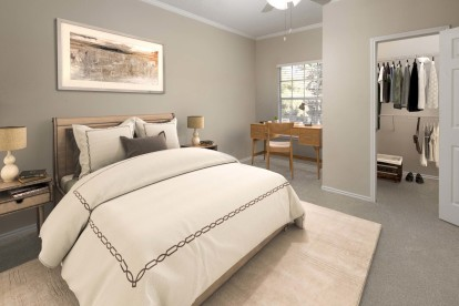 Bedroom with closet and space for a home office