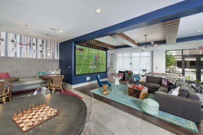 Resident clubroom with large television and lounge style seating