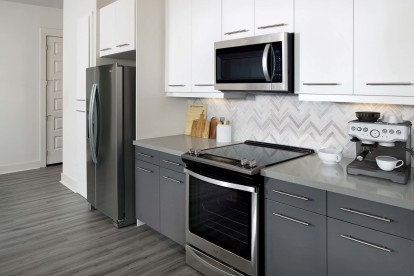 Kitchens with glass cooktops and French door refrigerator