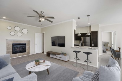 Living roo with fireplace open to kitchen