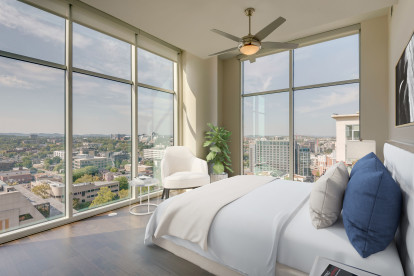Camden Music Row penthouse large bedroom with two walls of floor-to-ceiling windows