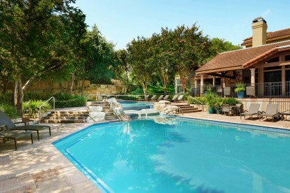 Pool with water feature and sundeck