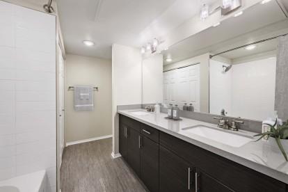 Modern bathroom with dual vanity sinks