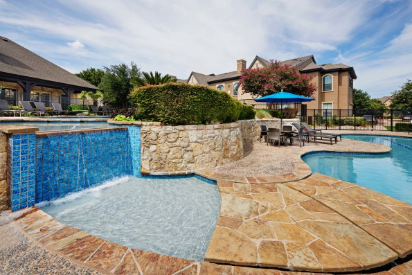 Resort style pool with water feature