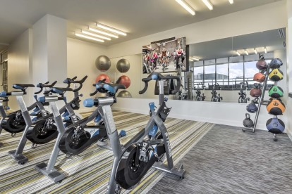 Two 24 hour fitness centers yoga and cycling studio