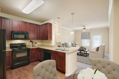 Open kitchen dining leading into large living room
