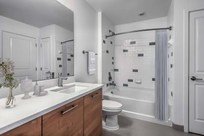 Bathroom with satin nickel fixtures and garden style bathtub