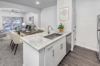 Open concept kitchen, dining, living room with spacious balcony.