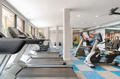 Fitness center with cardio machines treadmills spin bikes and ellipticals