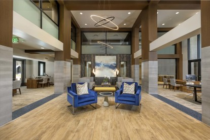 Resident lobby lounge entrance with double height ceiling