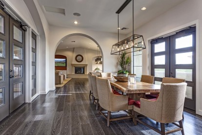Resident clubhouse dining area with light fixture and wood style flooring