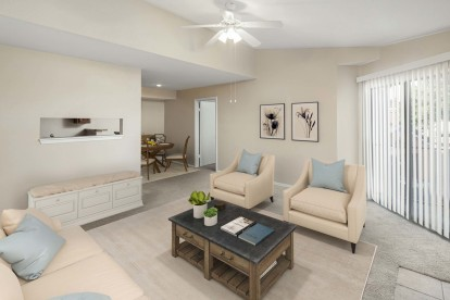 Living and dining room with opening to kitchen carpet flooring and ceiling fan