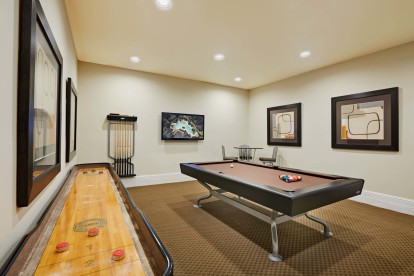 Game room with billiards and shuffleboard