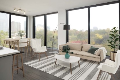 Living room with floor-to-ceiling windows and city views
