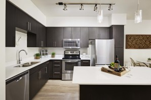 Modern style kitchen with quartz countertops and stainless steel appliances