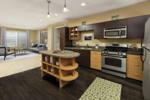Open concept kitchen with two toned cabinetry and stainless steel appliances
