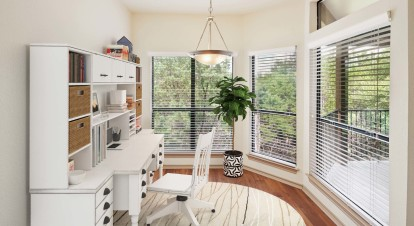 Flex space with home office windows and wood look flooring