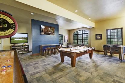 Game room with billiards shuffleboard and foosball