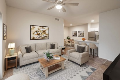 Open concept living room with ceiling fan and dining area and barstool seating