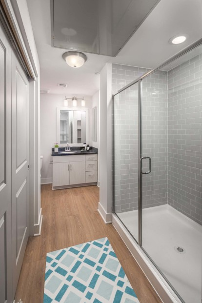 Bathroom with stand up shower and closet