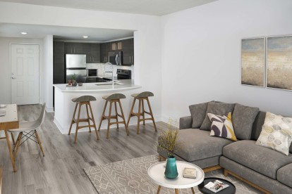 Open concept kitchen with quartz countertops and energy efficitnent stainless steel appliances