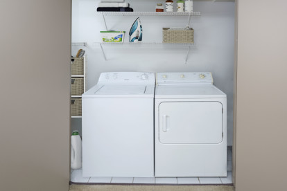 Full size washer and dryer with shelving