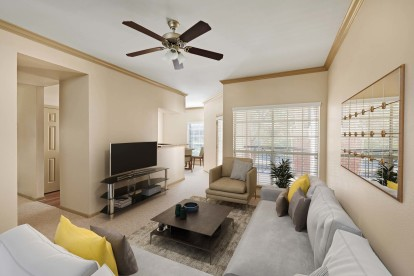 Living room with 9 ft ceilings with crown molding