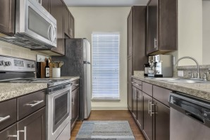Kitchen with granite style countertops and wood look flooring
