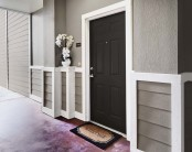 Apartment entrance with door bell and welcome mat