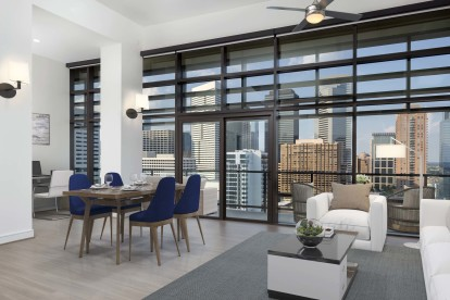 Penthouse with spacious living area and dining room with downtown and toyota center views
