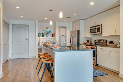 Kitchen with island seating, pantry and built-in desk