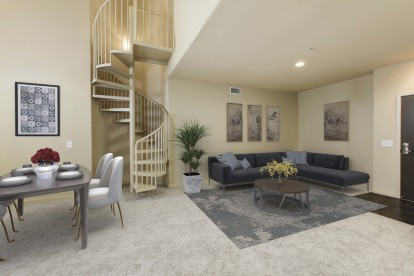 Open concept dining and living area near loft stairs