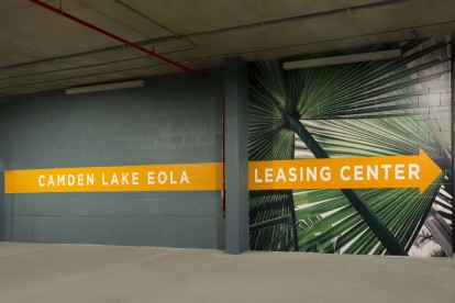 Parking garage directional signage. Follow us this way to find your new home.