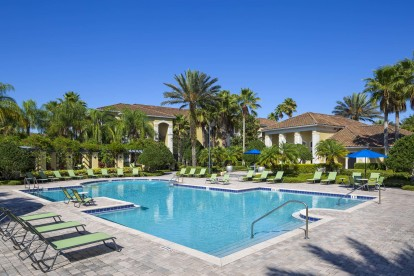 Pool surrounded by beautiful tropical landscaping