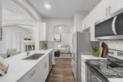 Kitchen with stainless steel appliance