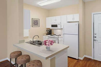 Neighborhood one kitchen with laminate countertops white appliances and white cabinetry
