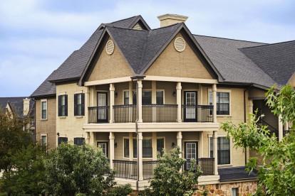 Building exterior showing wrap around balconies