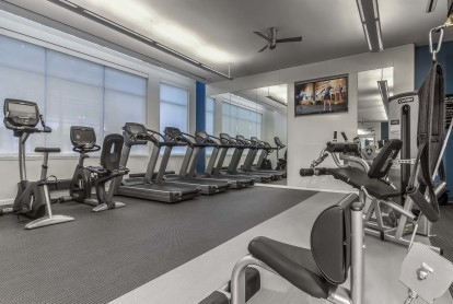Motion fitness center with cardio and strength training equipment