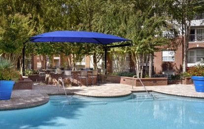 Resort style pool with outdoor cooking and dining area