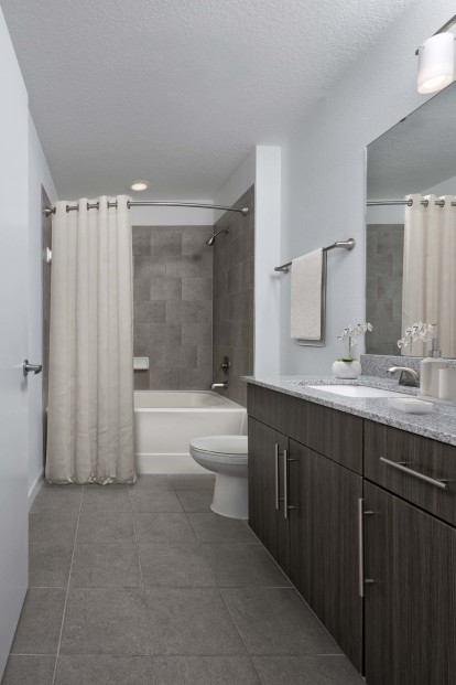 Bathroom with curved shower rod
