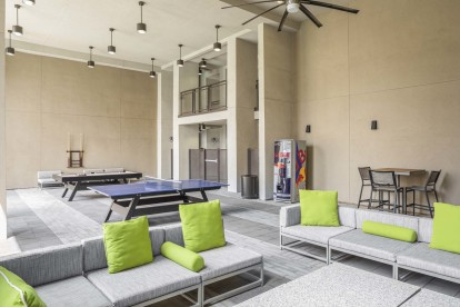 Covered outdoor lounge with seating and games