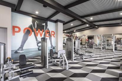 24 hour fitness center with strength training equipment including smith machine
