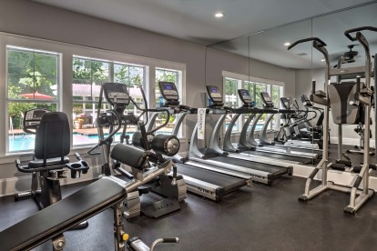 Fitness center with cardio equipment at Camden Lake Pine